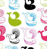 Funny seamless pattern with colorful whales silhouettes Royalty Free Stock Images