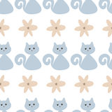 Funny seamless pattern with cute cats and flowers. Blue, brown, white color. Vector illustration Royalty Free Stock Image