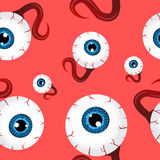 Funny seamless pattern with eyeballs. Over red background Stock Photos