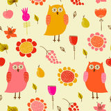 Funny seamless pattern with owls and flowers. Royalty Free Stock Photography