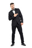 Funny secret agent with finger gun hand gesture looking away. Full body length portrait isolated over white studio background Royalty Free Stock Images