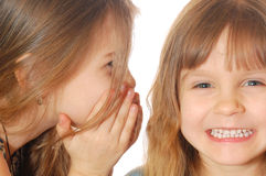 Funny secret talk. Two little girls having a secret funny chat Royalty Free Stock Photos