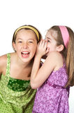 Funny Secrets. Two young gradeschool girls telling secrets and laughing Stock Images