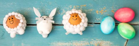 Funny selfmade animal shaped figures and colorful easter eggs on. Wooden background, flatlay Stock Photo
