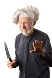 Funny senior chef with knife Stock Photo
