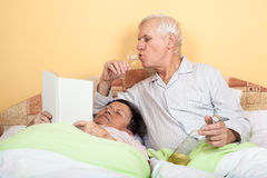 Funny senior couple in bed Royalty Free Stock Images