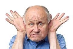 Funny senior man. Senior funny bald man is making grimaces Stock Image