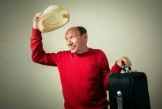 Funny senior man with travel bag. Portrait of the funny senior man with travel bag Stock Photos