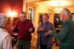 Funny senior people smiling and dancing at home party. Funny group senior people smiling and dancing at home party royalty free stock photo