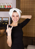 Funny sexy blonde girl with towel on her head in spa salon Royalty Free Stock Photography