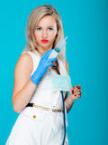 Funny sexy girl doctor nurse with syringe stethoscope. Medical person for health insurance. Vivid blue background Royalty Free Stock Image