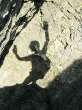Funny shadow. A shadow projected on a rock wall generates the outline of a funny creature Royalty Free Stock Image