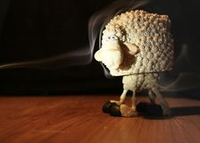 Funny sheep. Covered in smoke Royalty Free Stock Photography