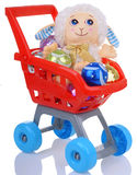 Funny sheep and christmas balls in shopping cart Royalty Free Stock Photo