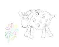 Funny sheep with flower stock photo