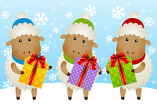 Funny sheep with gift boxes. On blue winter background Royalty Free Stock Photos