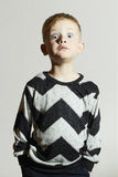 Funny shock face child in sweater.children trend.little boy.emotion. Fashionable kids stock photography