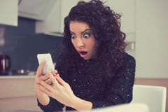 Funny shocked anxious woman looking at phone seeing bad photos message. Closeup portrait funny shocked anxious woman looking at phone seeing bad photos message Stock Photos