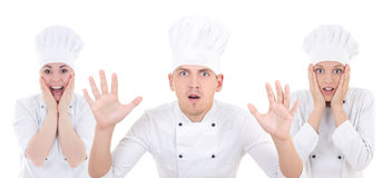 Funny shocked man and two women in chef uniform isolated on whit Stock Photography