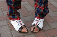 Funny shoes. Performer on the street with funny shoes Stock Photo