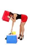 Funny  shopaholic woman Royalty Free Stock Photos