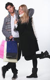 Funny shopping couple Stock Images