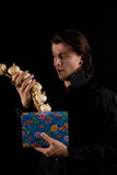 Funny shot of amazed vampire with gift box Stock Image
