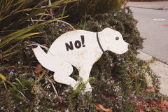 Funny sign against canine exkcrements Royalty Free Stock Photography