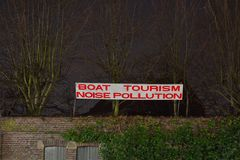 Funny sign: boat tourism noise pollution. Funny warning protest sign: boat tourism noise pollution Royalty Free Stock Photography