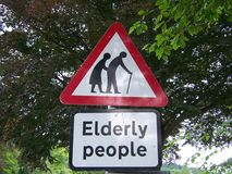 Funny Sign of Elderly People. A funny red, black, and white sign warning to watch out for elderly people royalty free stock images
