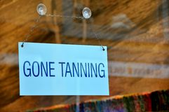 Funny sign: gone tanning  Stock Photo