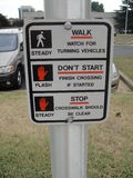Funny Sign. Its a funny sign which explains how to use a side walk lights Stock Photo