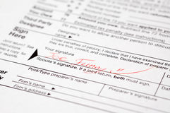 Funny signed tax form Royalty Free Stock Photos