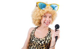Funny singer   woman with mic. And sunglasses  isolated on white Stock Photo