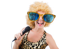 Funny singer   woman with mic. And sunglasses  isolated on white Royalty Free Stock Image
