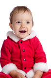 Funny singing baby in Santa Claus clothes Stock Photos