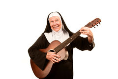 Funny Singing Nun. With old guitar in black habit Royalty Free Stock Photos