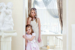 Funny sisters posing in elegant dresses Royalty Free Stock Photography