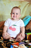 Funny sitting baby Stock Photography