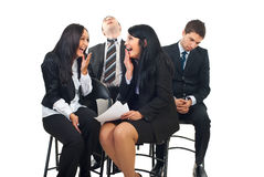 Funny situation at conference. Two business men fell asleep and snoring at the conference and two business women laughing out loud about this funny situation stock photo