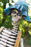 Funny skeleton. Ghost sculpture in amusement park Stock Photography
