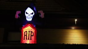 Skeleton grave with RIP dark background Halloween. Funny skeleton graveyard night RIP stock video footage