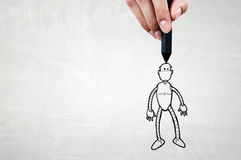 Funny sketched robot. Human hand drawing with marker robot model Stock Photo