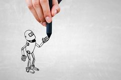 Funny sketched robot. Human hand drawing with marker robot model Stock Photography