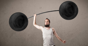 Funny skinny guy lifting weights Royalty Free Stock Image