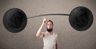 Funny skinny guy lifting weights. Funny skinny guy lifting incredible weights Royalty Free Stock Photography