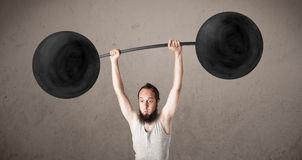 Funny skinny guy lifting weights Royalty Free Stock Photos