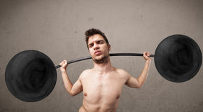 Funny skinny guy lifting weights Stock Images