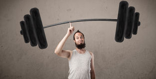Funny skinny guy lifting weights Stock Photos
