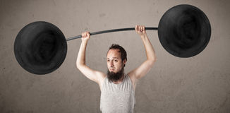 Funny skinny guy lifting weights Royalty Free Stock Photo